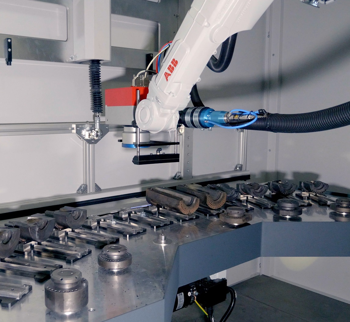 RMA Laser Processing cleaning cell robot ABB processing head
